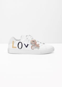https://www.stories.com/gb/Shoes/Sneakers/Feminine_Love_Sneakers/582741-0568645001.2